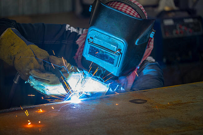 Welder performing working on structural steel.