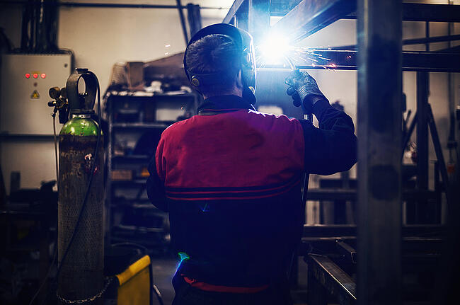 Welder working on large project.