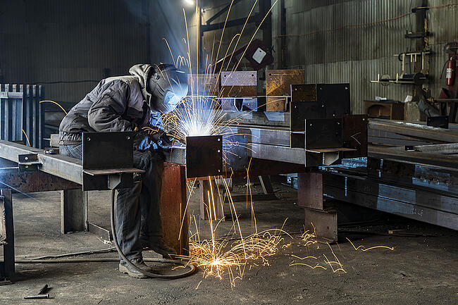 Welding industrial steel parts.